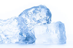 Ice cube. Transparent ice cube on the white background stock photography