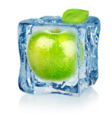 Ice cube and apple. Isolated on a white background Royalty Free Stock Photo