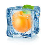 Ice cube and apricot isolated Royalty Free Stock Photos