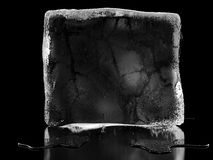 Ice cube background. Ice cube at black background with reflections Stock Images