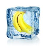 Ice cube and banana Royalty Free Stock Photos