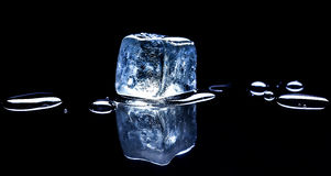 Ice cube on black background Stock Photo