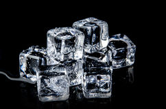 ice cube on the black background with reflection Royalty Free Stock Image