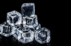 ice cube on the black background with reflection Royalty Free Stock Photography