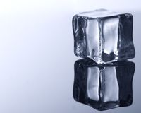 ice cube on blue background. royalty free stock image
