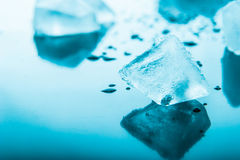 Ice cube in the blue background horizontal Stock Photos