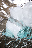 Ice cube on blue gel Royalty Free Stock Images