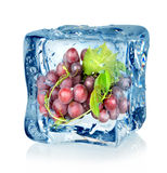 Ice cube and blue grapes Royalty Free Stock Photo