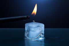 Ice cube candle is lit Stock Photos
