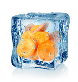 Ice cube and carrot. Isolated on a white background Royalty Free Stock Images