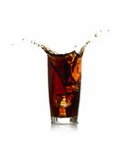 Ice cube droped in cola glass Stock Image