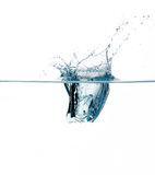Ice Cube Dropping. Splashes. Ice Cube Dropping in Healthy Water Royalty Free Stock Image