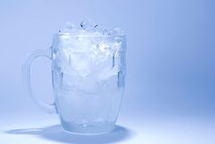 Ice cube in glass Royalty Free Stock Images
