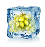 Ice cube and green grapes Royalty Free Stock Photography