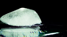 Ice Cube Melting and Moving on a Glass Surface. Many Ice Cube is Melting and Moving on a Glass Surface. Frozen water ice in a glass Surface melting turning again stock footage