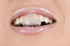 Ice cube in the mouth Royalty Free Stock Photo