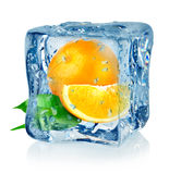 Ice cube and orange. Isolated on a white background royalty free stock photos