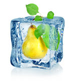 Ice cube and pear. Isolated on a white background royalty free stock image