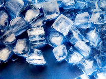 Ice cube on plastic blue tray Royalty Free Stock Photography