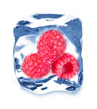 Ice cube and raspberries Royalty Free Stock Photo