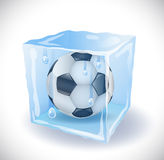 Ice cube with soccer ball Royalty Free Stock Images