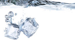 Ice cube Splash in the chilly water Royalty Free Stock Photography