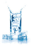 Ice cube splash in a glass of water Royalty Free Stock Photos