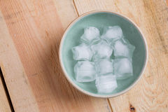 Ice cube with star shape in bowl royalty free stock image
