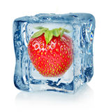 Ice cube and strawberry. Isolated on a white background Royalty Free Stock Photography