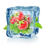 Ice cube and strawberry isolated Stock Image