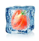 Ice cube and tomato. Isolated on a white background Royalty Free Stock Photography