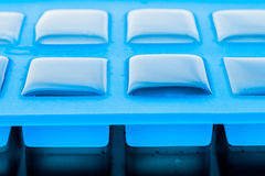 Ice cube tray with ice close-up Royalty Free Stock Photos