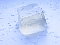 An ice cube with water droplets Stock Photography