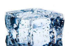 Ice cube with water drops isolated Royalty Free Stock Photos