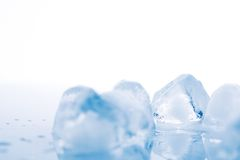 Ice cube on white background Royalty Free Stock Images