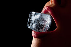 Ice cube in woman's mouth Stock Photography