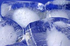 Ice cubes. Ice cube on wet blue background Stock Photo