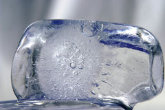 Ice cubes. Ice cube on another ice cube with grey background Stock Images