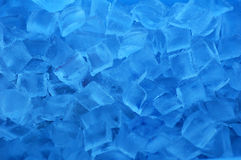 Ice Cubes. Capture blue light in a white cooler on a summer day Stock Photos