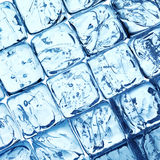 Ice cubes background. Background with ice cubes in blue light stock photo