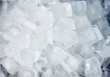 Ice cubes background. A background or texture made of ice cubes Stock Images