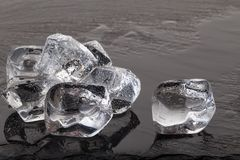 Ice cubes on black slate board Royalty Free Stock Image