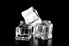 Ice cubes on black table. Selective focus Stock Photography