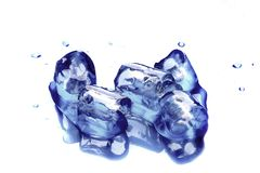 Ice cubes on blue background. With reflexion, isolated, with small water drops Stock Photography