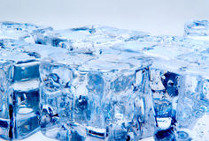 Ice cubes on blue background Royalty Free Stock Image