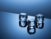 Ice cubes on blue background Stock Images