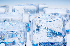 Ice cubes on blue background Royalty Free Stock Photos