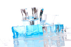 Ice cubes in blue light Stock Images