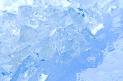 Ice cubes in blue light. Arctic, background, blue Royalty Free Stock Photos