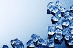 Ice cubes in blue light Stock Photos